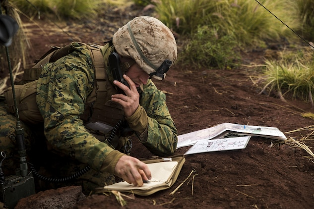 First Lt. Steven M. Murphy makes a call for fire over the radio, giving locations to an artillery battery to provide suppressing fire March 9 during Dragon Fire Training Exercise 15-2 at Pohakuloa Training Area, Hawaii. Forward observers provide artillery batteries with coordinates to fire on and also confirm impacts, ensuring the battery is hitting the target. Murphy, a Crofton, Maryland, native, is an artillery officer in the liaison section with 1st Battalion, 12th Marine Regiment, 3rd Marine Division, III Marine Expeditionary Force.