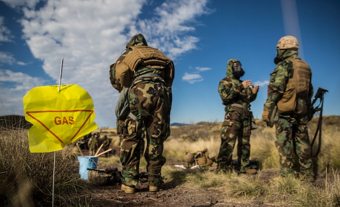 Marines go through a simulated decontamination center after a scenario simulating a chemical attack March 13 during Dragon Fire Exercise 15-2 at Pohakuloa Training Area. The Marines are with Headquarters Battery, 12th Marine Regiment, 3rd Marine Division, III Marine Expeditionary Force.