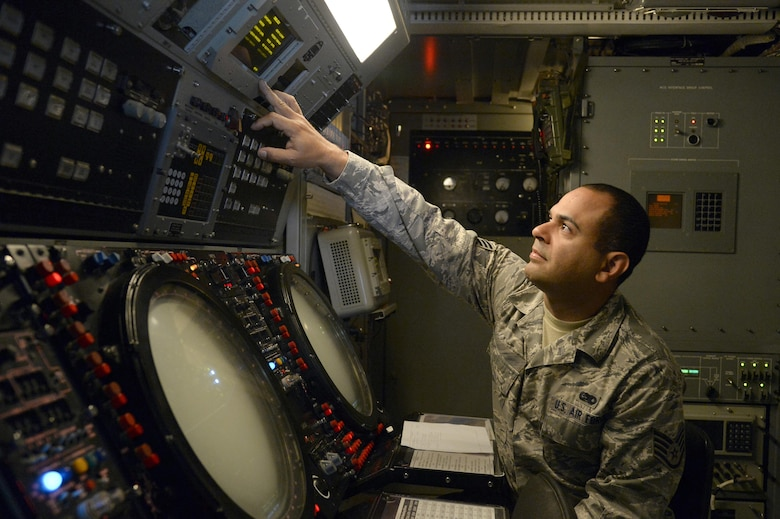 Staff Sgt. Wilfredo, radar maintenance technician, verifies the parameters and enters weather daily values on a TPS-75 radar system to accurately calculate the target altitude at an undisclosed location in Southwest Asia March 24, 2015. The TPS-75 radars assist in providing air coverage and support to the Expeditionary Air Control Squadron's current mission. Wilfredo is currently deployed from the Air National Guard's 141st Air Control Squadron out of Ramey Air Force Base, Puerto Rico. (U.S. Air Force photo/Tech. Sgt. Brown/RELEASED)