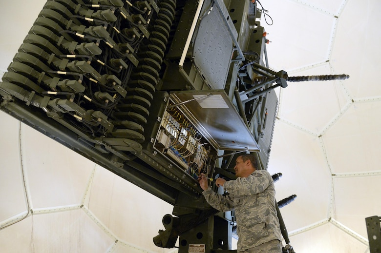 Staff Sgt. Pedro, radar maintenance technician, conducts a performance maintenance inspection on the antenna low-noise amplifier at an undisclosed location in Southwest Asia March 24, 2015. Radar maintenance technicians ensure serviceability and functionality of equipment in support of the mission. Pedro is currently deployed from the Air National Guard's 141st Air Control Squadron out of Ramey Air Force Base, Puerto Rico. (U.S. Air Force photo/Tech. Sgt. Brown/RELEASED)