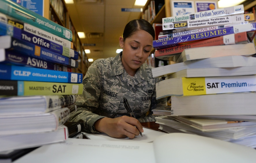 U.S. Air Force Senior Airman Kayla Lassalle, 27th Special Operations Contracting Squadron contracting specialist, makes use of library resources March 25, 2015 at Cannon Air Force Base, N.M. The Air Force recently made several changes to the tuition assistance program that could affect some recipients of TA in significant ways. (U.S. Air Force photo illustration/Staff Sgt. Alex Mercer)