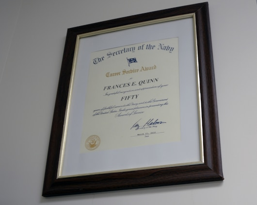 A 50-year service award signed by Ray Mabus, secretary of the Navy, hangs on the wall in Fran Quinn's office at Naval Branch Health Clinic, Albany, aboard Marine Corps Logistics Base Albany.
