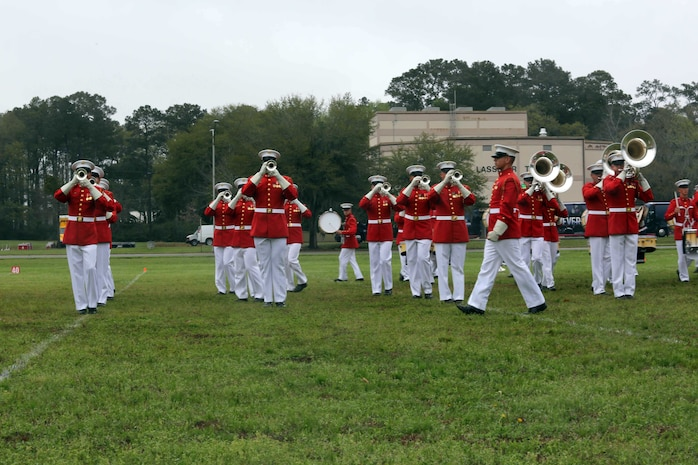 The Marine Corps Battle Color Detachment performs at Marine Corps Air Station Beaufort, March 23. The detachment is composed of three performing ceremonial units from Marine Barracks, Washington, D.C.: the Marine Corps Drum and Bugle Corps, the Marine Corps Silent Drill Platoon, and the Marine Corps Color Guard. This highly skilled detachment travels worldwide to demonstrate the discipline and professionalism of United States Marines. The performance was open to the public and attended by local leaders and students of the Lowcountry.