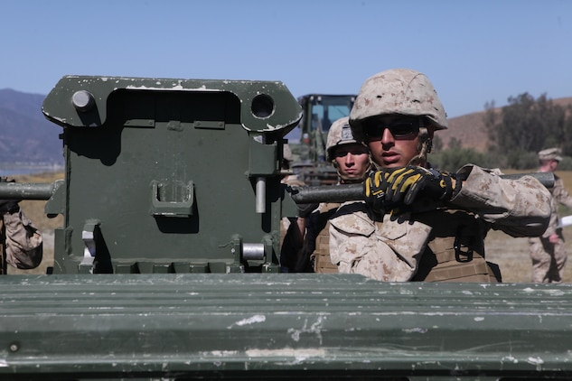 Marines from Bridge Company, 7th Engineer Support Battalion, 1st Marine Logistics Group, conduct a bridge exercise at Lake Elsinore, Calif., March 24, 2015. Marines built an improved ribbon bridge and a medium girder bridge. This event marks the first time a continuous span bridge from shore to shore has been built since 2002.