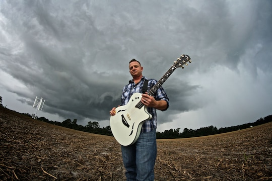 Mike Corrado, a country music singer/song writer stands in a field for photos to promote his music. Corrado is also a lieutenant colnoel is the Marine Corps currently serving as the Deputy Assistant Chief of Staff G-3, 4th Marine Division, Marine Forces Reserve.