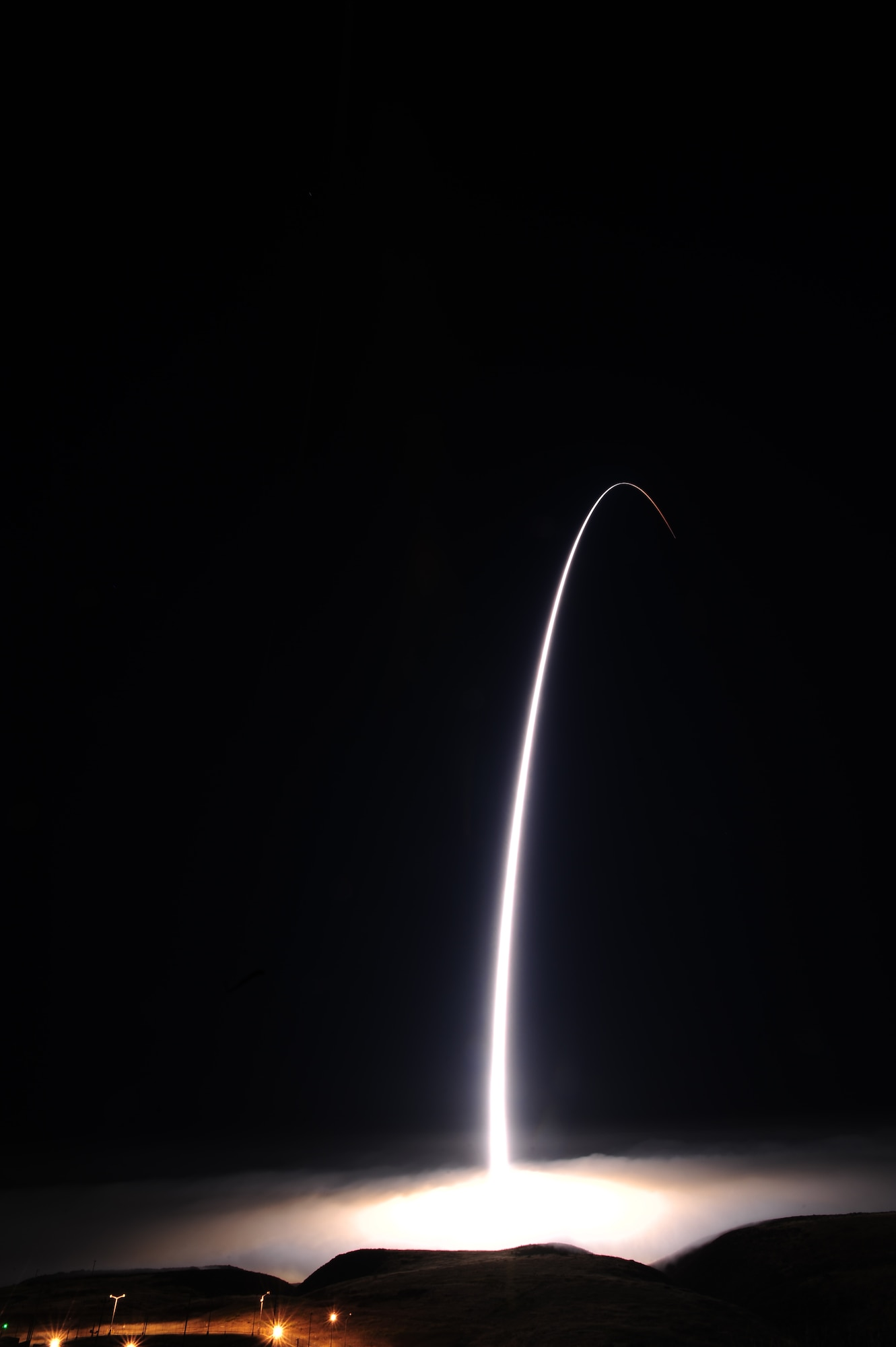 An unarmed Minuteman III intercontinental ballistic missile (ICBM) accelerates toward a test range near Guam, March 27, 2015, after launching from Vandenberg Air Force Base, Calif. The ICBM was the second fired for testing and evaluation purposes in the course of a week, with both Malmstrom and F. E. Warren AFBs sending crews and randomly selected missiles to Vandenberg AFB. (U.S. Air Force photo/Joe Davila)
