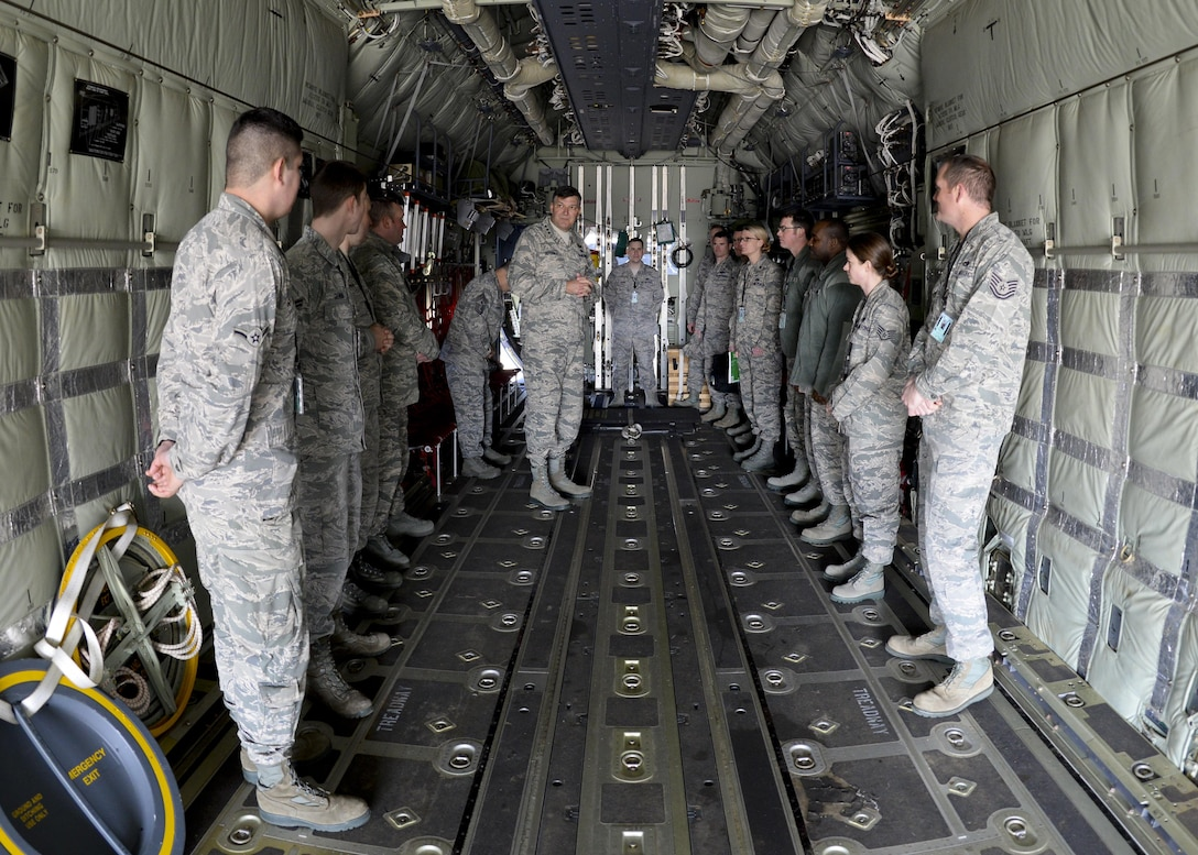 U.S. Air Force Lt. Gen. Brad A. Heithold, center, Air Force Special Operations Command commander, speaks to Airmen assigned to the 352nd Special Operations Wing inside a MC-130J Commando ll during a tour March 23, 2015, on RAF Mildenhall, England. Heithold visited various units to discuss the AFSOC mission and its priorities before the official redesignation ceremony of the 352nd Special Operations Wing.