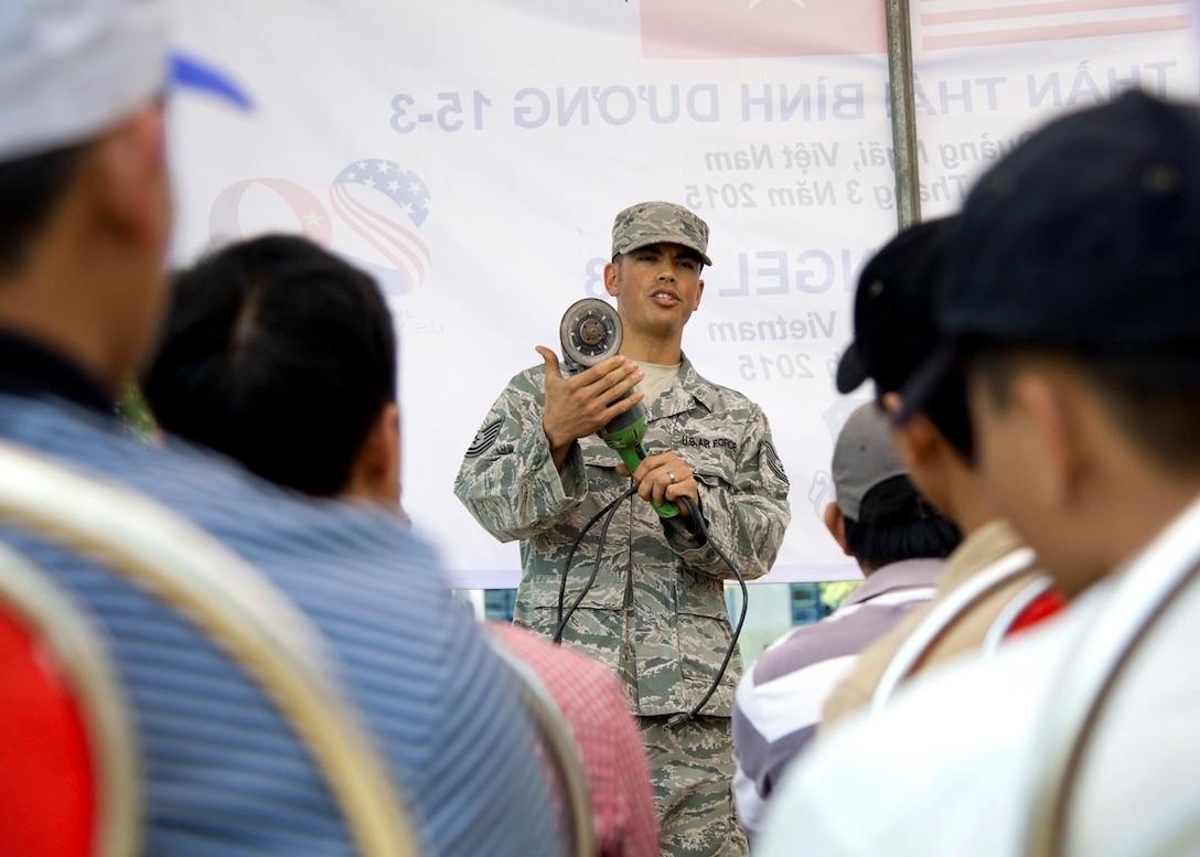 Tech. Sgt. Giles Dame leads a work safety class with Vietnam People's Army Air Defense members at Binh Thanh Dong primary school during an Operation Pacific Angel 15-3 event March 23, 2015, in Quang Ngai Province, Vietnam. PACANGEL is a total force, joint and combined humanitarian assistance operation led by the U.S. Pacific Air Forces. The operation promotes interoperability among U.S. military, host nation and multilateral military and civilian organizations. Dame is a structural craftsman assigned to the 18th Civil Engineer Squadron at Kadena Air Base, Japan. (U.S. Air Force photo/Staff Sgt. Tong Duong)