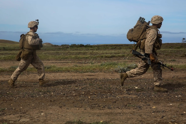 U.S. Marines with Lima Company, Battalion Landing Team 3rd Battalion, 1st Marine Regiment, 15th Marine Expeditionary Unit, run toward their objective during Composite Training Unit Exercise (COMPTUEX) on San Clemente Island, Calif., March 22, 2015. As part of the 15th MEU's ground combat element, the Marines practiced their urban movement and room clearing skills in preparation for their deployment. (U.S. Marine Corps photo by Cpl. Anna Albrecht/Released)