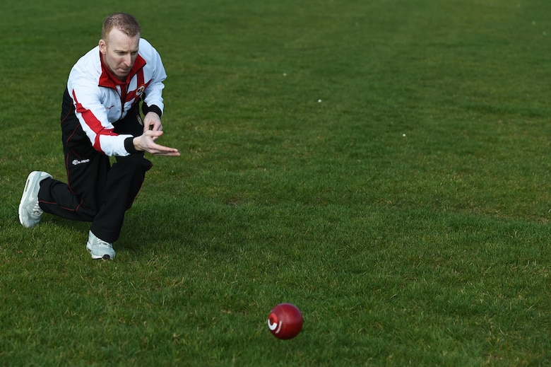 "Nick Brett rolls a ball, called a ""bowl,"" down the athletic field March 23, 2015, at Royal Air Force Alconbury, England. Currently, Brett is ranked as the number bowler in the world. Brett is the water and fuels shop chief for the 423rd Civil Engineer Squadron. (U.S. Air Force photo/Staff Sgt. Jarad A. Denton)"