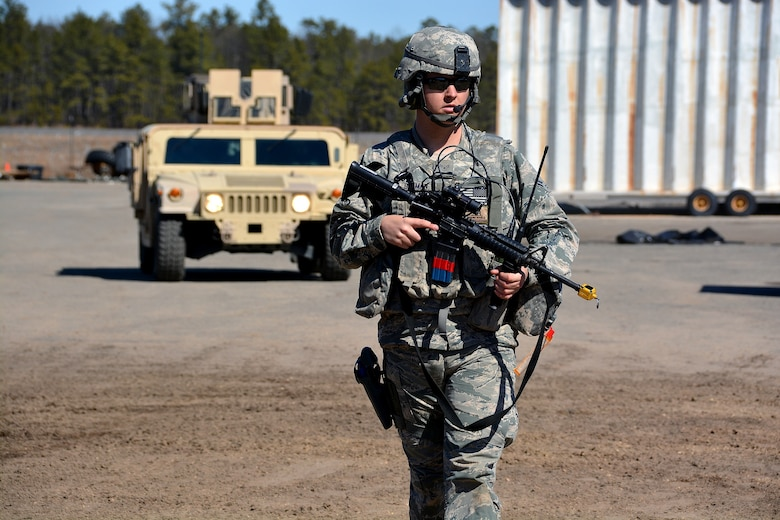 Airman 1st Class Andrew Denman patrols a campsite following a mock attack from opposing forces, March 12, 2015, during Exercise Eagle Flag 15-2, at Joint Base McGuire-Dix-Lakehurst, New Jersey. Eagle Flag is a U.S. Air Force Expeditionary Center exercise used to execute and evaluate mobility operations and expeditionary combat support. Denman is assigned to the 570th Global Mobility Readiness Squadron. (U.S. Air Force photo/Senior Airman Charles Rivezzo)