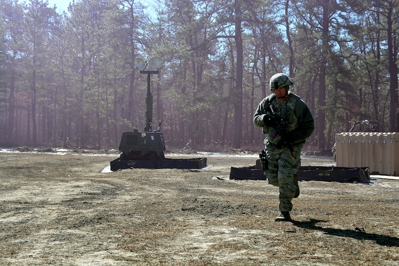 Tech. Sgt. Cory Little runs for cover during a mock attack from opposing forces, March 12, 2015, during Exercise Eagle Flag 15-2, at Joint Base McGuire-Dix-Lakehurst, New Jersey. Eagle Flag is designed for developing, testing and rehearsing the expeditionary combat support library of capabilities. Little is assigned to the 571st Global Mobility Readiness Squadron. (U.S. Air Force photo/Senior Airman Charles Rivezzo)
