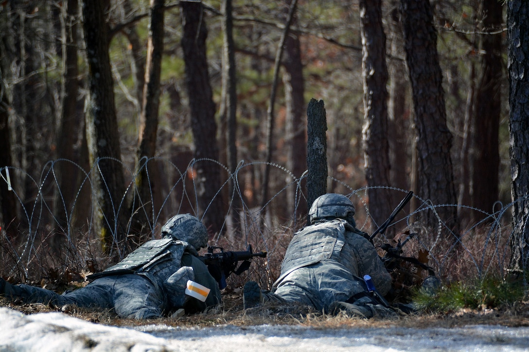 Airmen from the 570th Contingency Response Group, maintain a defensive fighting position during a mock attack from opposing forces, March 12, 2015, during Exercise Eagle Flag 15-2, at Joint Base McGuire-Dix-Lakehurst, New Jersey. The exercise is designed for developing, testing and rehearsing the expeditionary combat support library of capabilities. (U.S. Air Force photo/Senior Airman Charles Rivezzo)