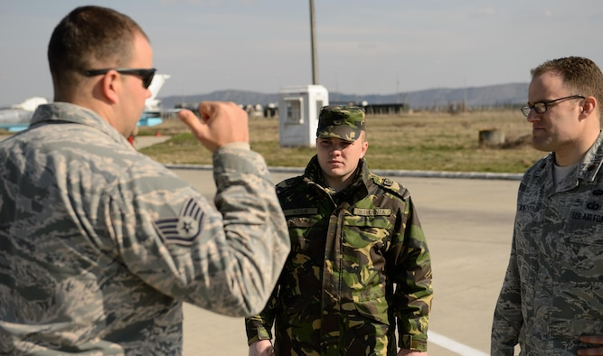 Airmen from the U.S. and Romanian air forces discuss ways to improve the flightline March 18, 2015, at Campia Turzii, Romania. The Airmen are part of the training event Dacian Warhawk, which is designed to improve expertise and increase interoperability. (U.S. Air Force photo/Staff Sgt. Armando A. Schwier-Morales)
