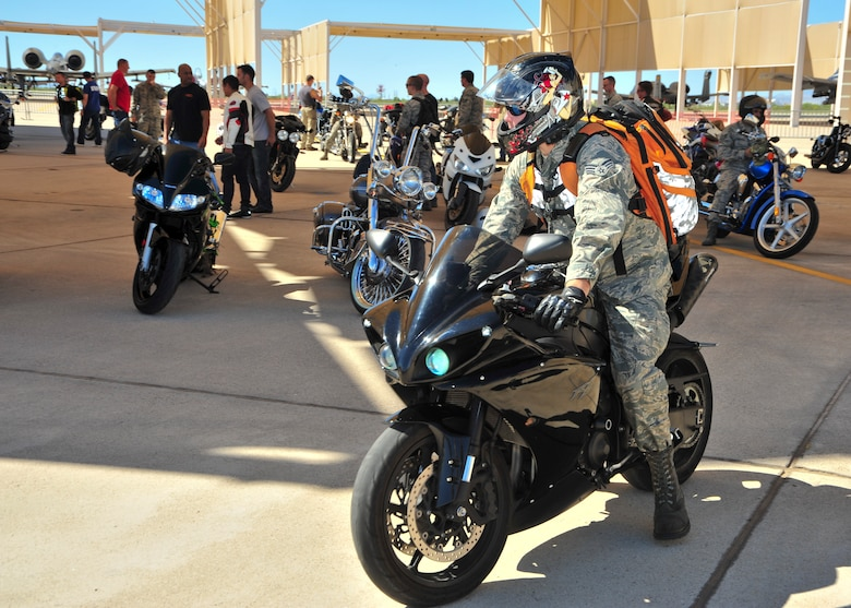 An Airman motorcyclist prepares to take off during a motorcycle safety rally at Davis-Monthan Air Force Base, Ariz., March 27, 2015.  Approximately 115 Airmen from D-M participated in the rally.  (U.S. Air Force photo by Airman 1st Class Chris Massey/Released)
