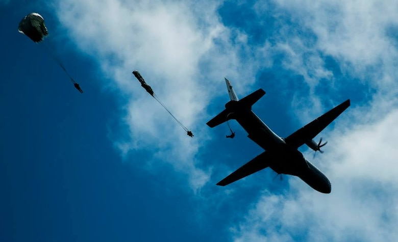 Five Colombia Air Force airmen parachute from a Colombian Air Force Casa 295 aircraft attempting to land as close to target during the first air drop with United States Air Force personnel aboard on March 3, 2015 at Marandua Air Force Base in Colombia, South America. (Photo by U.S. Air Force Tech. Sgt. Matthew Hannen)