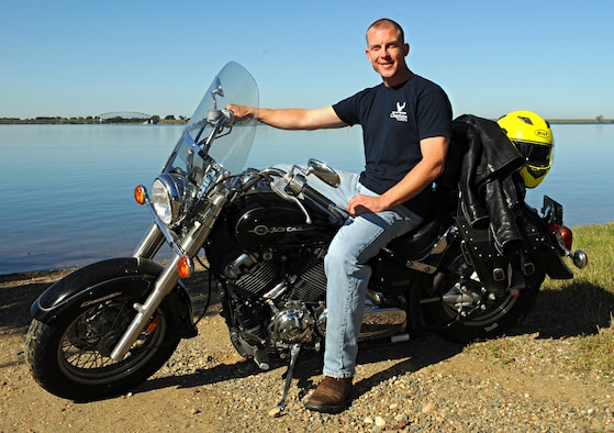 Chaplain (Capt.) R. Brenner Campbell, 9th Reconnaissance Wing chaplain, poses with his motorcycle at Camp Far West Lake in Wheatland, Calif., March 27, 2015. (U.S. Air Force photo by Airman 1st Class Ramon A. Adelan/Released)