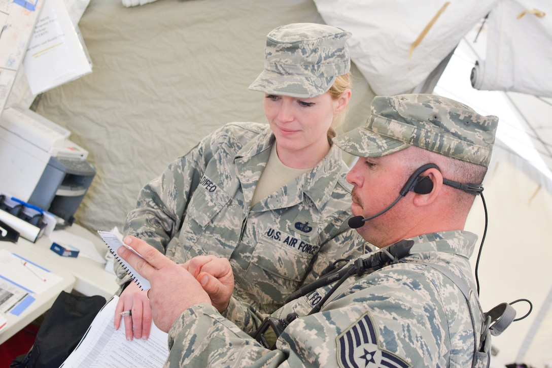 U.S. Airmen assigned to the Missouri National Guard's Homeland Response Force (HRF) transport a mock patient March 20, 2015 at Camp Gruber in Braggs, Okla. The guardsmen were evaluated on their ability to respond to a large scale natural disaster or terrorist attack. HRFs are validated every three years. (U.S. Air National Guard photo by Tech. Sgt. Michael Crane)