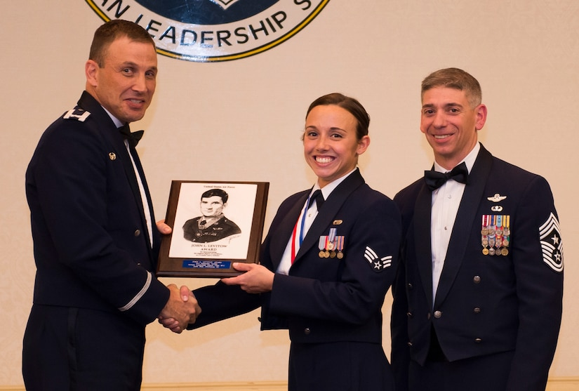 Senior Airman Samantha Varden from the 437th Airlift Wing receives the John L. Levitow Award from Col. Johnny Lamontagne, 437th AW commander, and Chief Master Sgt. Shawn Hughes, 437th AW command chief March 26, 2015, at the Charleston Club on Joint Base Charleston, S.C. Varden received the highest award in her graduation class because she demonstrated the traits of a true leader. (U.S. Air Force photo/Airman 1st Class Clayton Cupit)