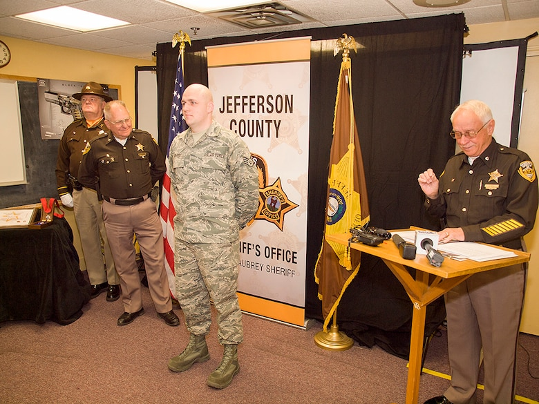 Staff Sgt. Brent Reichardt, an aircraft hydraulics specialist in the Kentucky Air National Guard's 123rd Maintenance Squadron, was awarded the Medal of Valor from the Jefferson County Sheriff's Office on Feb. 20, 2015, for actions he took during a shooting incident at a Louisville, Ky., high school in 2014. Reichardt, who works full-time as a Jefferson County Sheriff's deputy, is currently deployed to the Persian Gulf in support of airlift operations across the U.S. Central Command Area of Responsibility. (Photo courtesy Jefferson County Sheriff's Office)