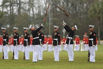 The world-renowned Marine Corps Battle Color Detachment performs at Marine Corps Air Station Beaufort, March 23. The detachment is composed of three performing ceremonial units from Marine Barracks, Washington, D.C.: the Marine Corps Drum and Bugle Corps, the Marine Corps Silent Drill Platoon, and the Marine Corps Color Guard. This highly skilled detachment travels worldwide to demonstrate the discipline and professionalism of United States Marines. The performance was open to the public and attended by local leaders and students of the Lowcountry.