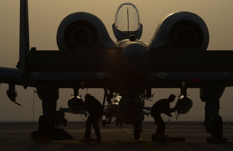 Airmen work on an A-10 Thunderbolt II from the 163rd Expeditionary Fighter Squadron after its arrival here in November. Since their arrival to the 332nd Air Expeditionary Group, A-10s have expended nearly 50,000 rounds of ammunition and dropped approximately 500 bombs and maverick missiles in support of Operation INHERENT RESOLVE. (U.S. Air Force photo by Tech. Sgt. Jared Marquis)