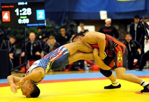 Sgt. Max Nowry of the U.S. Army World Class Athlete Program gets a leg lace on Lance Cpl. Rueben Navejas of Marine Corps Base Camp Lejeune, North Carolina, en route to a 9-2 victory in the 57-kilogram freestyle division of the 2015 Armed Forces Wresting Championships to help All-Army to a 22-14 victory over All-Marine Corps on Saturday at the Morale, Welfare and Recreation Special Events Center on Fort Carson, Colorado. U.S. Army photo by Tim Hipps, IMCOM Public Affairs