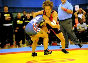 All-Army wrestler Capt. Leigh Provisor (top in red) of Fort Carson, Colorado, eventually pins All-Marine Corps Cpl. Melissa Apodaca of Marine Corps Base Camp Lejeune, North Carolina, in the inaugural women's match in the Armed Forces Wrestling Championships on Saturday at the Morale, Welfare and Recreation Special Events Center on Fort Carson. U.S. Army photo by Tim Hipps, IMCOM Public Affairs
