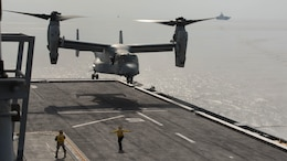 A U.S. Marine Corps MV-22B Osprey prepares to land on the flight deck of the Republic of Korea ship Dokdo (LPH 6111), at sea, March 26, 2015. This was the first time an Osprey has landed on a ROK amphibious assault ship. The aircraft is with Marine Medium Tiltrotor Squadron 262 (Reinforced), 31st Marine Expeditionary Unit. The Marines of the 31st MEU are embarked aboard the forward-deployed amphibious assault ship USS Bonhomme Richard (LHD 6) and are currently participating in Korean Marine Exchange Program 15 during the MEU's annual Spring Patrol of the Asia-Pacific region.