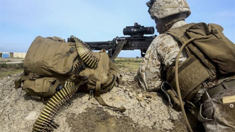 A U.S. Marine with Lima Company, Battalion Landing Team 3rd Battalion, 1st Marine Regiment, 15th Marine Expeditionary Unit, watches over the objective during an airfield seizure mission as part of Composite Training Unit Exercise on San Clemente Island, California., March 22, 2015. These Marines inserted onto the island to execute a raid and practice their urban combat skills.