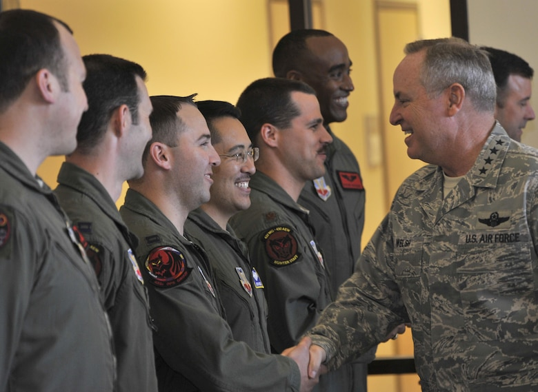 Chief of Staff of the Air Force Gen. Mark A. Welsh III meets with 432nd Wing/432nd Air Expeditionary Wing pilots before a roundtable sit-down March 24, 2015, during his visit to Creech Air Force Base, Nev. During his discussion, Welsh highlighted the changes within the Air Force such as the new enlisted performance report system, force management and the importance of the intelligence, surveillance and reconnaissance mission. (U.S. Air Force photo/Airman 1st Class Christian Clausen)