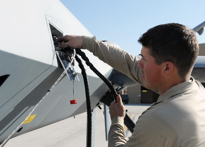 A 451st Expeditionary Aircraft Maintenance Squadron Airman performs preflight checks prior to launching an MQ-9 Reaper March 20, 2015, at Kandahar Airfield, Afghanistan. Airmen assigned to the 451st EAMXS provide 24/7 maintenance support to the Air Force's largest Reaper unit, ensuring ground troops are supported around the clock. (U.S. Air Force photo/Staff Sgt. Whitney Amstutz)