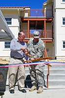 U.S. Rep. Sam Farr and Fort Hunter Liggett Commander Lt. Col. Michael B. Bailey cut the ribbon officially opening a new housing complex at the Monterey County, California, installation March 27, 2015. The U.S. Army Corps of Engineers Sacramento District managed the construction of the project. The new housing units are configured into three five-unit buildings, each designed to LEED-Silver energy efficiency standards to help the installation meet its net zero goals. One unit is designed for two soldiers with separate bathrooms and bedrooms. Construction began in November 2013 at a cost of about $4.5 million.