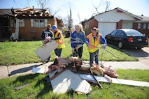 U.S. Air Force Academy cadets collect debris from the streets of Moore, Okla., March 26, 2015. A late-afternoon tornado struck the small community, just outside Oklahoma City, March 25, 2015. Fifteen cadets were in Moore March 23-27 to build homes with Habitat for Humanity as part of their Alternative Spring Break Program. (U.S. Air Force photo/John Van Winkle)