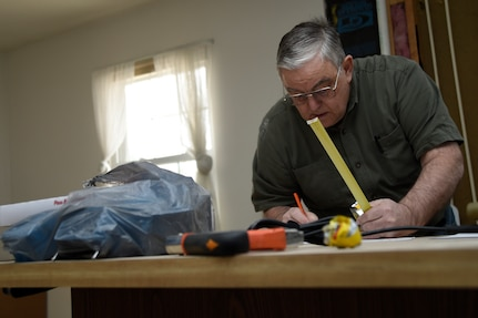 Allen Lewey, Church of Jesus Christ of Latter-day Saints missionary, finished the blueprints of the kitchen layout of a home in Bowie, Md., Jan. 29, 2015. The house belongs to Tech. Sgt. Melvin Mateo, an 89th Communications Squadron Government Network Operations Center crew chief. The home is being renovated to meet the requirements of his special-needs daughter. (U.S. Air Force photo/Airman 1st Class Ryan J. Sonnier)