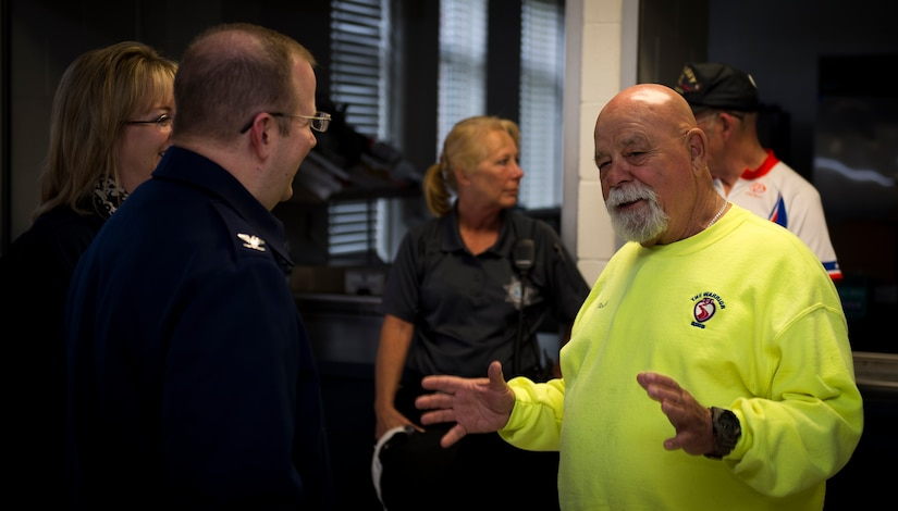 Bob Racine, co-founder of the Warrior Ride organization, talks with Col. Jeffrey DeVore, Joint Base Charleston commander and his wife, Michelle, about the goals and vision of the Warrior Ride. The ride took place on March 27, 2015 and ended at the Reagan Center on Naval Weapons Station Charleston, S.C. The Warrior Ride uses adaptive bicycling and other morale building events, such as kayaking and golf, as tools for recreation and rehabilitation for wounded warriors. (U.S. Air Force photo/Airman 1st Class Clayton Cupit)