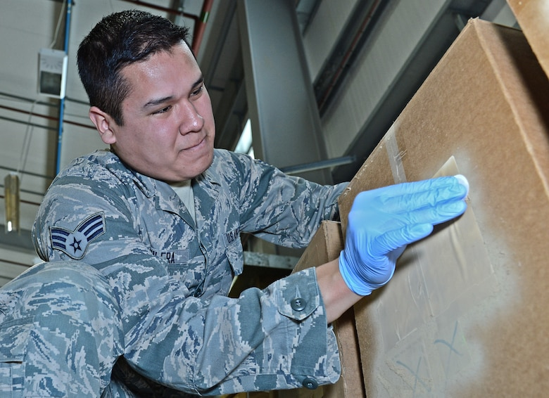 Senior Airman Antonio Aguilera, 48th Operations Support Squadron assistant bioenvironmental engineering technician, performs a radiation test to sample for any leaks or radiation sources on a shipment at Royal Air Force Lakenheath, England, March 23, 2015. Aguilera was nominated for a Liberty Spotlight because he embodies the core value of Excellence In All We Do. (U.S. Air Force photo by Airman 1st Class Erin R. Babis/Released)