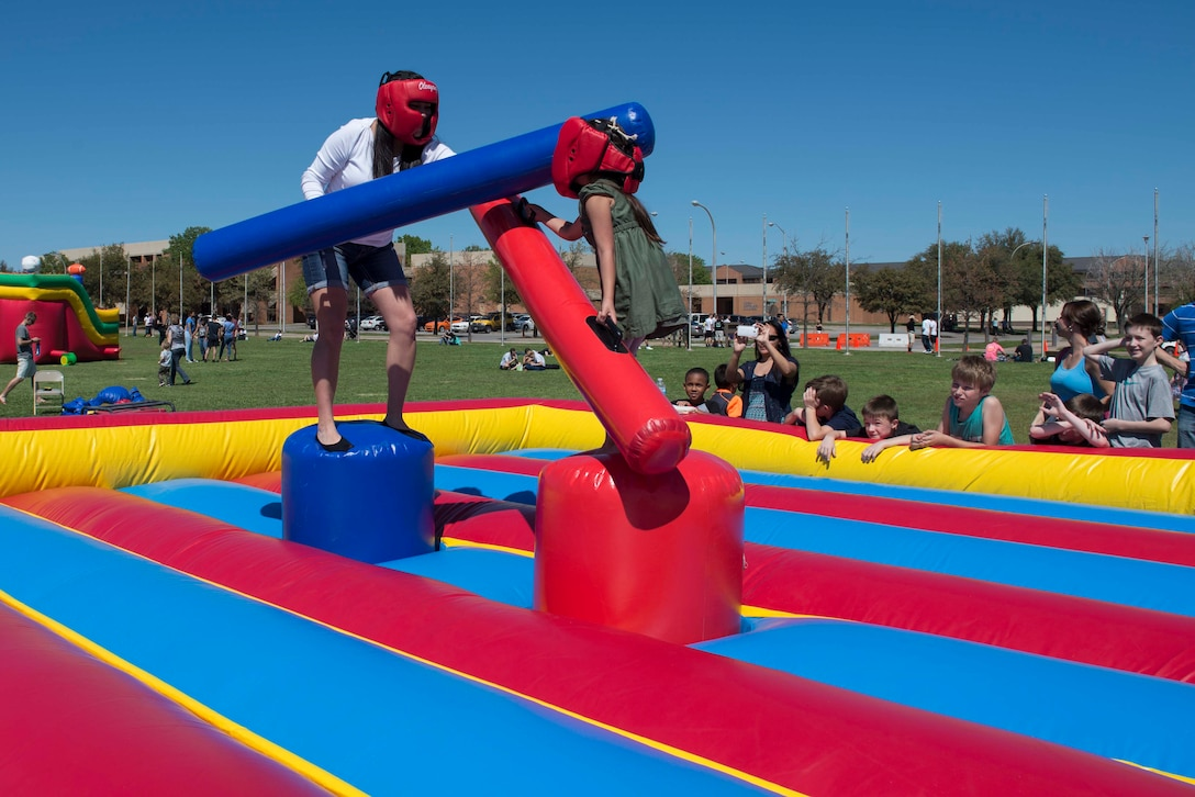 U.S. Army Texas National Guard Staff Sgt. Laurie Gutierrez, 149th Human Recourse Company and native of San Antonio, jousts with her five-year-old daughter, Viviana Marrero, at the Sheppard Air Force Base, Texas, Spring Picnic March 28, 2015. The picnic was hosted by the 82nd Force Support Squadron and is the second picnic to take place at Sheppard. (U.S. Air Force photo by Senior Airman Kyle Gese)