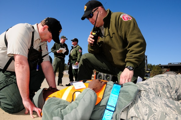 North Carolina Forest Service first responders assess a patient's simulated injury during Vigilant Guard 2015 exercise held at the 145th Civil Engineer Squadron-Regional Training Site in New London, N.C., March 6-8, 2015. Vigilant Guard is an exercise that provides an opportunity for Army and Air National Guard, North Carolina Emergency Management and county civilian partners to come together to train as true partners in order to respond effectively to natural disasters. (U.S. Air National Guard photo by Master Sgt. Patricia F. Moran, 145th Public Affairs/Released)