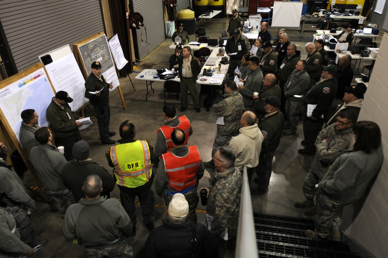 Members of the North Carolina Air and Army National Guard, state Division of Emergency Management and North Carolina Forest Service gather for a morning briefing to cover general control objectives for the incident scenario during the 2015 Vigilant Guard Exercise, March 7, 2015. This exercise, held March 6-8, 2015 at the 145th Civil Engineer Squadron Regional Training Site, New London, N.C., is designed to measure the effectiveness of National Guard forces supporting civilian activities following a hurricane. (U.S. Air National Guard photo by Staff Sgt. Julianne M. Showalter, 145th Public Affairs/Released)