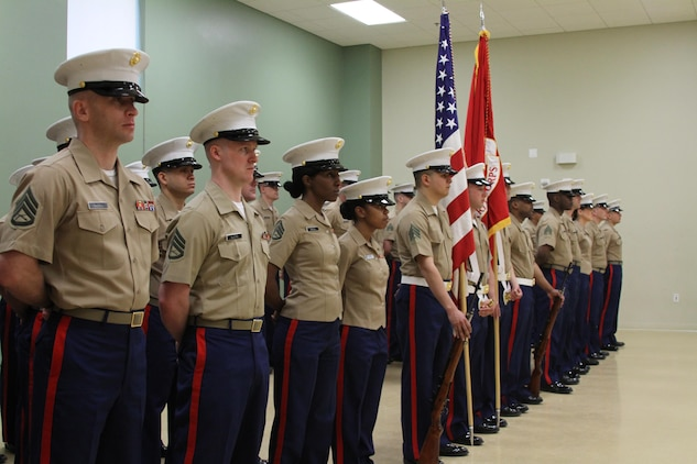 Marines stand at parade rest during a relief and appointment ceremony at Fort Detrick, Maryland, March 26, 2015. During the ceremony, U.S. Marine Corps Sgt. Maj. William E. Sweeney, a Loveland, Colorado native, relinquished his post at Marine Corps Recruiting Station Frederick to Sgt. Maj. Alonzo P. Baxter from Center Cross, Virginia. (U.S. Marine Corps photo by Sgt. Anthony J. Kirby/Released)
