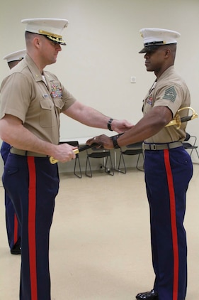 U.S. Marine Corps Sgt. Maj. Alonzo P. Baxter, right, a native of Center Cross, Virginia, receives the noncommissioned officer sword from U.S. Marine Corps Maj. Paul B. Bock, Recruiting Station Frederick Commanding Officer, during a relief and appointment ceremony on Fort Detrick, Maryland, March 26, 2015. The sword is passed from one sergeant major to the next, signifying the transfer of sacred trust. During the ceremony, U.S. Marine Corps Sgt. Maj. William E. Sweeney, a native of Loveland, Colorado, relinquished his post as Recruiting Station Frederick Sergeant Major to Baxter. (U.S. Marine Corps photo by Sgt. Anthony J. Kirby/Released)