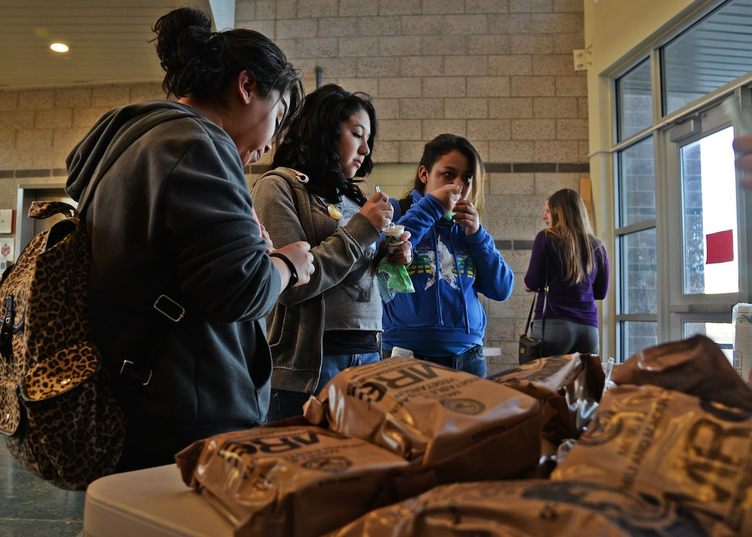 Students sample Meals, Ready to Eat at the Math in the Military event March 26, 2015 at Gattis Middle School in Clovis, N.M. The event offered a hands-on approach to show how math is used every day. (U.S. Air Force photo/Airman 1st Class Chip Slack)