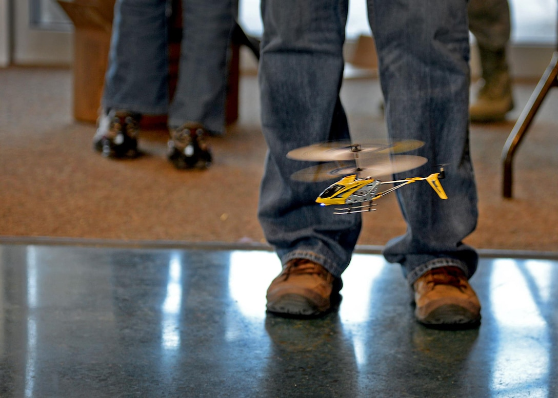 A student operates a remote-control helicopter at the Math in the Military event March 26, 2015 at Gattis Middle School in Clovis, N.M. The activity demonstrated how ratios and other mathematical equations help Airmen pilot various air frames. (U.S. Air Force photo/Airman 1st Class Chip Slack)