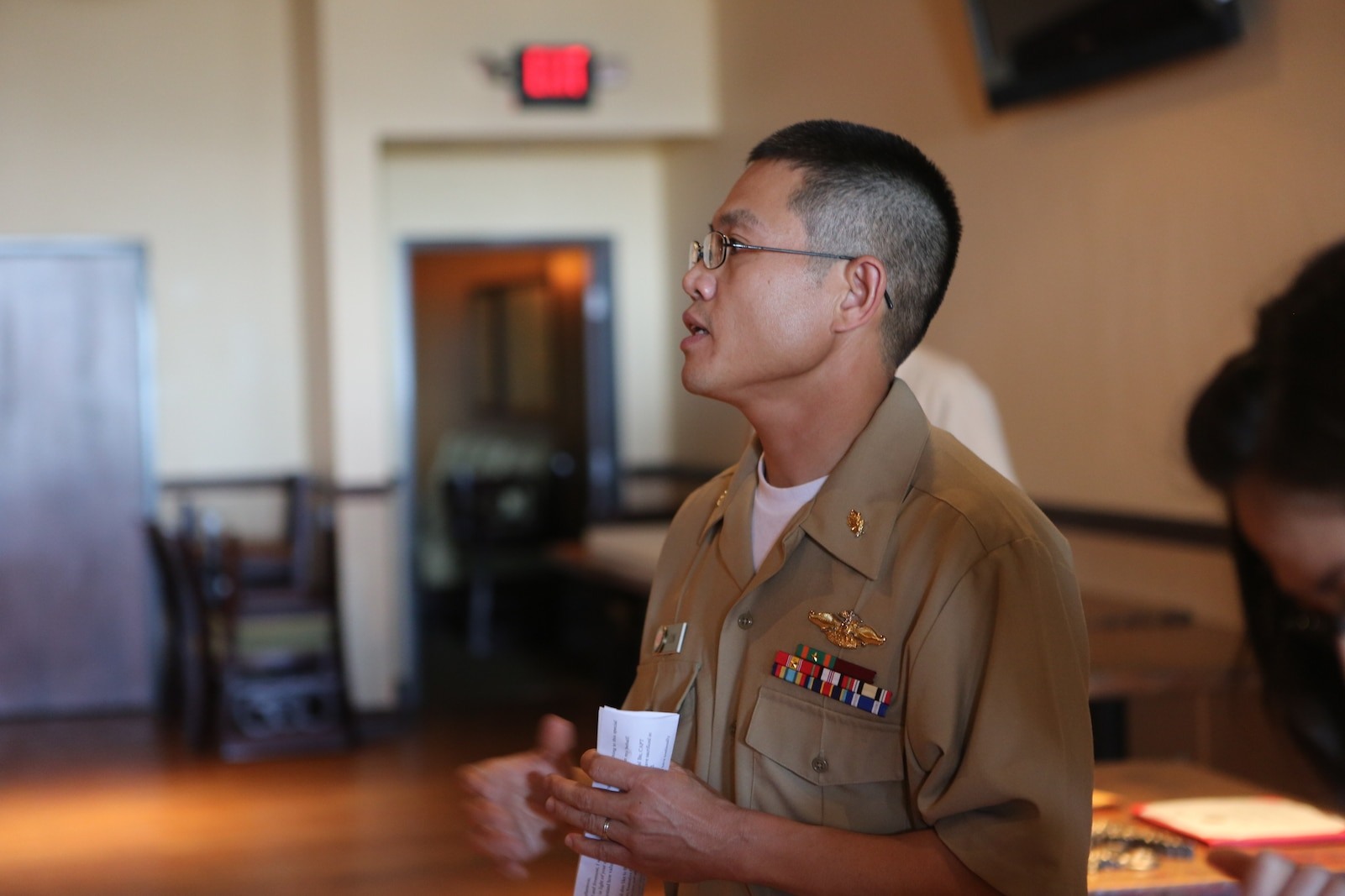 """Lt. Cmdr. Vinh T. Ton, dentist for 1st Dental Battalion, speaks after receiving the Weedon E. Osborne Award following a ceremony at Pacific Views Event Center aboard Camp Pendleton, Calif, March 27, 2015. The award is earned by a dental officer who makes significant contributions to operational readiness. It is presented annually by the Marine Corps Association. The award is named in honor of Lt. j.g. Weedon E. Osborne, Dental Corps, U.S. Navy, who was killed in action during the battle of Belleau Wood in France in 1918. """"When I reflect upon the pool of other extraordinarily dedicated and talented practitioners nominated for this award, words cannot express the depth of my humility for having been chosen for this honor,"""" said Ton. """"I would like to share the honor of this award with all those who were also nominated, truly any of you could have been selected for this award."""""""
