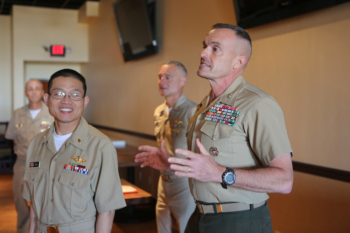 """Maj. Gen. Vincent A. Coglianese, commanding general for 1st Marine Logistics Group, speaks during an award ceremony for Lt. Cmdr. Vinh T. Ton, dentist for 1st Dental Battalion, at Pacific Views Event Center aboard Camp Pendleton, Calif, March 27, 2015. The Weedon E. Osborne award is earned by a dental officer who makes significant contributions to operational readiness. It is presented annually by the Marine Corps Association. The award is named in honor of Lt. j.g. Weedon E. Osborne, Dental Corps, U.S. Navy, who was killed in action during the battle of Belleau Wood in France in 1918. """"When I reflect upon the pool of other extraordinarily dedicated and talented practitioners nominated for this award, words cannot express the depth of my humility for having been chosen for this honor,"""" said Ton. """"I would like to share the honor of this award with all those who were also nominated, truly any of you could have been selected for this award."""""""
