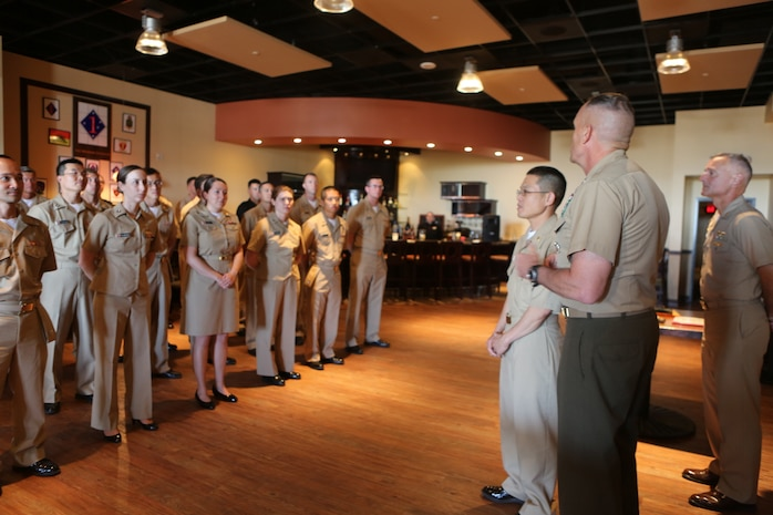"""Lt. Cmdr. Vinh T. Ton, dentist for 1st Dental Battalion, receives the LTJG Weedon E. Osborne award from Maj. Gen. Vincent A. Coglianese, commanding general for 1st Marine Logistics Group at Pacific Views Event Center aboard Camp Pendleton, Calif, March 27, 2015. The award is earned by a dental officer who makes significant contributions to operational readiness. It is presented annually by the Marine Corps Association. The award is named in honor of Lt. j.g. Weedon E. Osborne, Dental Corps, U.S. Navy, who was killed in action during the battle of Belleau Wood in France in 1918. """"When I reflect upon the pool of other extraordinarily dedicated and talented practitioners nominated for this award, words cannot express the depth of my humility for having been chosen for this honor,"""" said Ton. """"I would like to share the honor of this award with all those who were also nominated, truly any of you could have been selected for this award."""""""