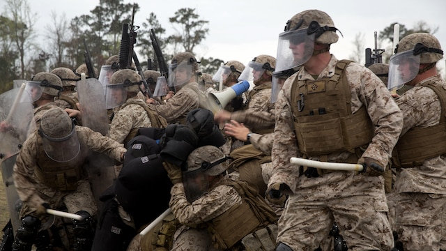 Marines with Golf Company and Echo Battery, 2nd Battalion, 6th Marine Regiment practice riot-control techniques aboard Marine Corps Base Camp Lejeune, N.C., March 27, 2015. The Marines conducted two weeks of non-lethal weapons training in preparation for an upcoming deployment.