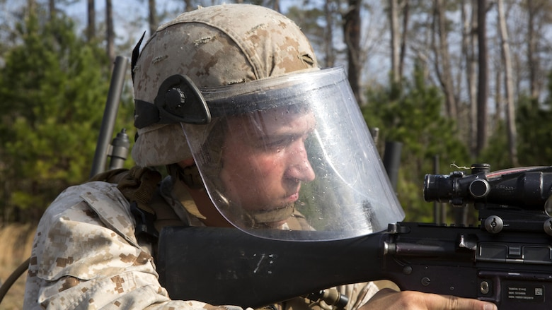 Lance Cpl. Brandon D. Tompkins, an artilleryman with Echo Battery, 2nd Battalion, 6th Marine Regiment participates in a live-fire, non-lethal weapons training exercise aboard Marine Corps Base Camp Lejeune, N.C. March 27, 2015. The Marines conducted a two week training course in preparation for an upcoming deployment.