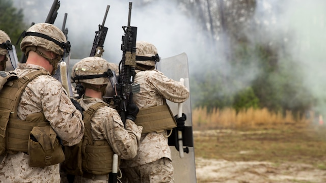 Marines with Golf Company and Echo Battery, 2nd Battalion, 6th Marine Regiment fire non-lethal rounds during a range exercise aboard Marine Corps Base Camp Lejeune, N.C., March 27, 2015. The Marines conducted two weeks of non-lethal weapons training in preparation for an upcoming deployment.